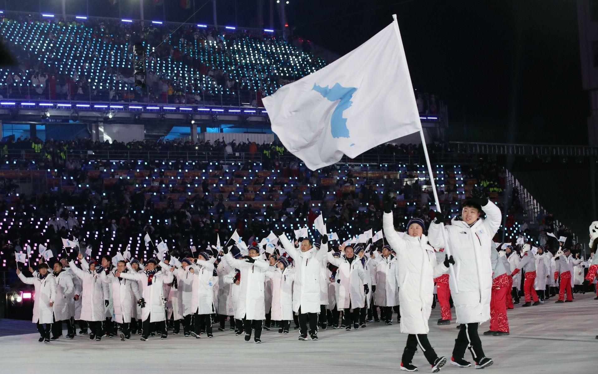 Unifiedinter-KoreanteamarrivesattheOpeningCeremonyofthePyeongChang2018OlympicGames