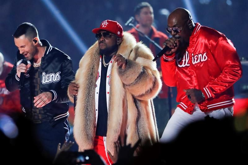 Rapper Big Boi (C), Maroon 5's Adam Levine (L) and Sleepy Brown (R) perform during the half time show of Super Bowl LIII