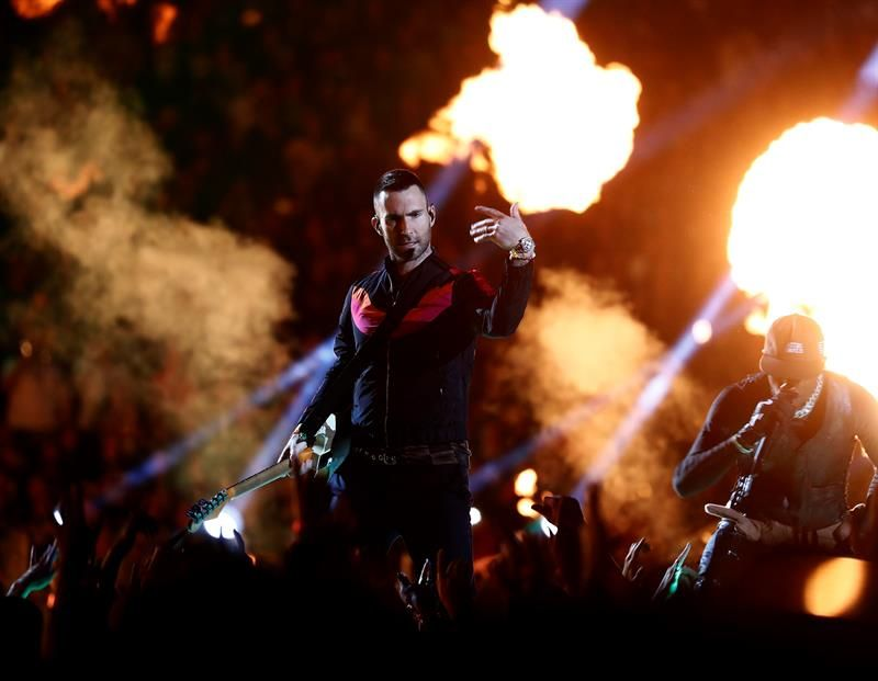 Adam Levine (L) of Maroon 5 and Travis Scott (R) perform during the halftime show of Super Bowl LIII