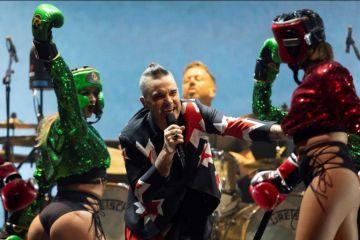 Robbie Williams conquista México con show irónico y energético